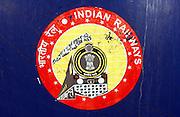 Photo by Heathcliff Omalley..Mughal Serai, Uttar Pradesh, India..Indian Railway Logo on a train at Mughal Serain Train Station near the holy city of Varanasi, where many of the express trains from Dehli to Calcutta stop.
