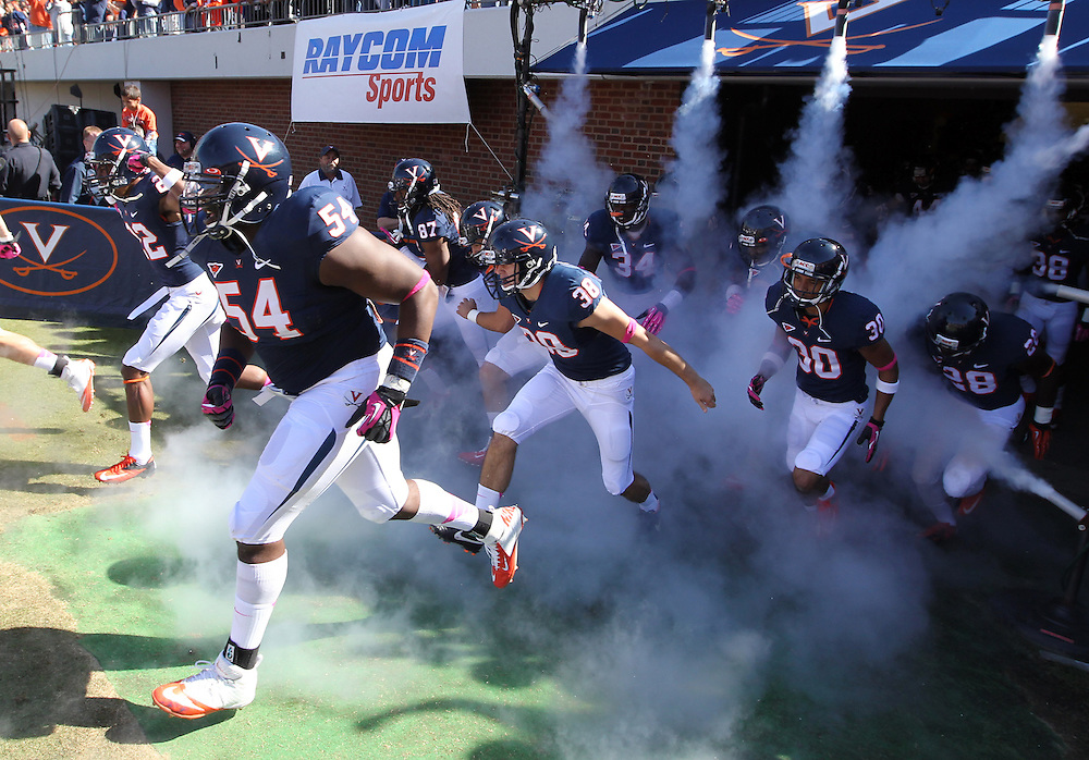 Virginia players take the field during the game against the Wake Forest at Scott Stadium in Charlottesville, Va. Wake Forest defeated Virginia 16-10.