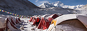 China, Tibet, view of Everest (Chomolongma - 29,029 ft. or 8848 m), prayer flags in morning sun, snow dusted on tents