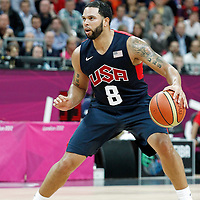 31 July 2012: USA Deron Williams looks to pass the ball during 110-63 Team USA victory over Team Tunisia, during the men's basketball preliminary, at the Basketball Arena, in London, Great Britain.
