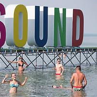 Revellers enjoy Balaton Sound music festival held on the shore of lake Balaton in Zamardi (about 110 km South-West of capital city Budapest), Hungary on July 5, 2018. ATTILA VOLGYI