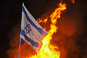 Israeli flag at a Lag Baomer a bonfire