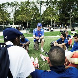PARIS, FRANCE. AUGUST 23, 2011. Andy Hook, technical director, explaining to the French homeless team what they should take into consideration as the hosting team during the Homeless World Cup. Photo: Antoine Doyen