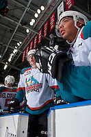 KELOWNA, CANADA - FEBRUARY 10: Cal Foote #25 and Devante Stephens #21 of the Kelowna Rockets stand on the bench against the Vancouver Giants on February 10, 2017 at Prospera Place in Kelowna, British Columbia, Canada.  (Photo by Marissa Baecker/Shoot the Breeze)  *** Local Caption ***