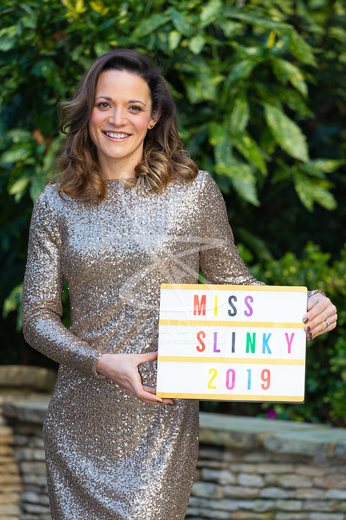Hayley Cook, 30, a mother of two has shed six stone five-and-a-half to be the mum she always wanted to be and has been crowned Slimming World's Miss Slinky 2019. Her gold dress by Ralph Lauren was chosen to mark the 50th anniversary of Slimming World. The Ritz, London, January 09 2019.