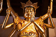 Gold buddhist spiritual figure inside wall of the Jade Buddha Temple in the city of Shanghai, China