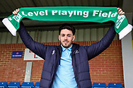 AFC Wimbledon defender Will Nightingale (5) holding up Level Playing Field scaRF during the EFL Sky Bet League 1 match between AFC Wimbledon and Bolton Wanderers at the Cherry Red Records Stadium, Kingston, England on 7 March 2020.