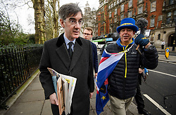 © Licensed to London News Pictures. 12/03/2019. London, UK. Brexiteer JACOB REES-MOGG is seen being confronted by anti-Brexit campaigner STEVE BRAY (right) in Westminster on the day MPs are due to hold a vote on Theresa May's Brexit deal. Parliament is expected to reject the Prime Ministers deal, with suggestions that there could be attempts to remove the PM if there is any delay to Brexit. Photo credit: Ben Cawthra/LNP