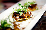 SHOT 1/6/12 2:07:33 PM - Paxia upscale Mexican restaurant in the Sunnyside neighborhood of Denver, Co. Tostadas de Tinga appetizer with shredded beef marinated in chipotle sauce and topped with lettuce, cheese and cream $5.99.(Photo by Marc Piscotty /  © 2012)