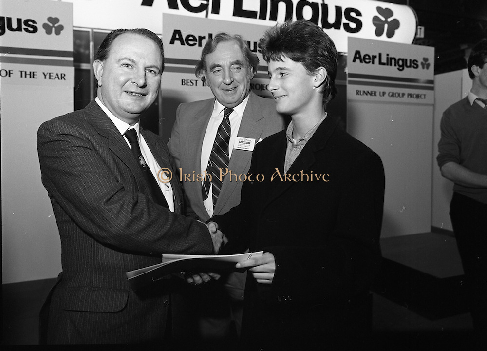 10/01/1986.01/10/1986.10th January 1986.The Aer Lingus Young Scientist of the Year Exhibition at the RDS, Dublin...Picture shows Con Power, (left) Director, Economic Policy, Confederation of Irish Industries presenting the CII Award for the Physical, Mathematical and Applied Sciences, Senior Pupils to Colman Byrnes, of the Methodist College, Belfast. Also pictured is Niall G. Weldon, Chairman of the Panel of Judges. Colman's winning project was entitled 'The Eight Directional Joystick'. ..