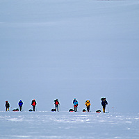 A guide leads mountaineers back to base camp after a multi-day ascent of Mount Vinson, the highest summit in Antarctica.