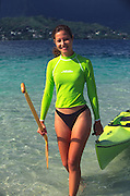 Polynesian woman, outrigger canoe, Kaneohe Bay, Oahu, Hawaii<br />
