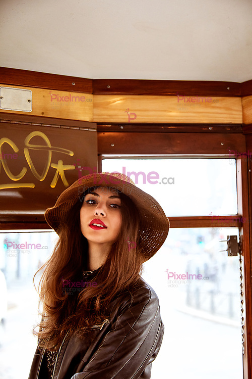 Portrait of a female model inside of a public tramway in Milan, Italy Europe during the day
