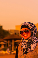 Arab woman enjoying the beach at the Radisson Blu Tala Bay Resort on the Gulf of Aqaba, Red Sea, near Aqaba, Jordan.