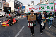 """Young Japanese people take part in the Global Strike for Future at the United Nations University, Shibuya, Tokyo, Japan.Friday March 15th 2019. Part of a global day of action in 98 countries and nearly 2,000 cities; this was Japan's second Fridays for Future event, known as """"School strikes"""", and took place from 2pm to 4pm with activists and students holding signs demanding leaders, internationally and nationally, take measures to reduce ecologically damaging activities. The movement was started in 2018 by Swedish schoolgirl, Greta Thunberg, who began striking from her lessons when she realised that adult leaders were doing nothing to ensure there would be the future she was studying for."""
