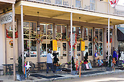Man by Old South Trading Post bookstore shop selling gifts and specialties, Main Street, Downtown Natchez, Mississippi USA