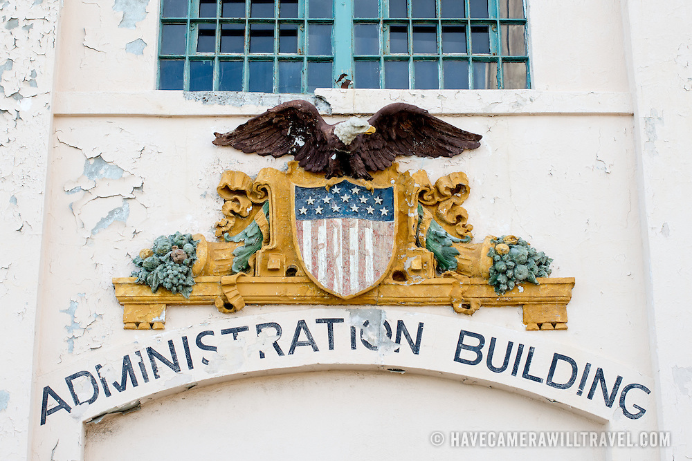 A sign with a government seal on the Administration Building of Alcatraz.