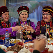 """New Year celebration by Buryati villagers living in Selenga in the Kabansk region along the shore at Russia's Lake Baikal. They live on the eastern shore and are descendants of Asiatic tribes, with Buddhist cultural influence. <br /> <br /> Crowned the """"Jewel of Siberia"""", Baikal is the world's deepest lake, and the biggest lake by volume, holding 20% of the world's fresh water. In the winter, the lake 31,722 square meter surface is entirely frozen with ice averaging 2 meters thick."""
