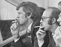 Football - 1979 / 1980 Fulham v Preston North End.<br /> <br /> Nobby Stiles - Manager of Preston North End<br /> <br /> Alan Kelly - assistant manager (left) both smoking a cigarette during the match