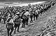 Russian Imperial Army: Column of infantry marching carrying full field kit, c1914.