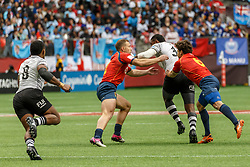 March 10, 2018 - Vancouver, British Columbia, U.S. - VANCOUVER, BC - MARCH 10: Waisea Nacuqu (#5) of Fiji drives through tackles from Francisco Hernandez (#6) and Jaike Carter (#2) of Spain during Game # 4- Fiji vs Spain Pool C match at the Canada Sevens held March 10-11, 2018 in BC Place Stadium in Vancouver, BC. (Photo by Allan Hamilton/Icon Sportswire) (Credit Image: © Allan Hamilton/Icon SMI via ZUMA Press)