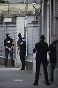 March 15, 2016 - Brussels, BELGIUM - <br /> <br /> Police seen during an intervention on the site of a shooting in the rue du Dries-Driesstraat in Forest-Vorst, Brussels, Tuesday 15 March 2016. The shooting took place during searches linked to the Paris terrorist attacks. Two members of federal police where injured in the operation and police is still searching for the shooter.<br /> ©Exclusivepix Media