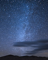 The northern milky way shines bright above the Kelso Sand Dunes in the Mojave National Preserve. At the top left is the Andromeda Galaxy. Clouds were moving across the sky quickly on this windy night.<br /> <br /> Date Taken: 1/30/14