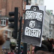 """The funeral of former Prime Minister Margaret Thatcher who died Monday April 8. The funeral of Margaret Thatcher and the huge costs of it has sparked controversy and a number of protesters turned up to show their dissent and to turn their back on the procession. The plackards says """"Rest of us in Poverty"""""""