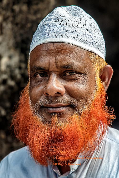 Holy Fashion Sense: A portrait of a pious muslim man with a fashionable orange beard, Mymensingh Bangladesh.