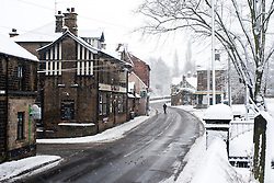 Monday January 21 - Winter Weather reaches Church Street Ecclesfield in Sheffield with the promise of more to follow.21 January 2013.Image © Paul David Drabble