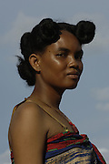Mahafaly woman (Those-who-make-taboos) showing braided hairstyle typical of the area. Near Betioky, south-west coast of MADAGASCAR<br />The Mahafaly probably arrived to Madagascar around the 12th centurey from Africa and live in the sw desert areas around Ampanihy and Ejida. They are farmers, with maize, sorgho and sweet potoatoes as their main crops and cattle rearing occupies a secondary place. They kept their independence under their own chiefs until French occupation and still keep the bones of some of their old chiefs - this is the 'Jiny' cult. The villages usually have a sacrificial post, the 'hazo mango' on their east side where sacifices are made. Their large rectangular stone tombs which are decorated with wooden carvings 'aloalo' and the horns of all the zebu slain at the funereal are very eleborate.