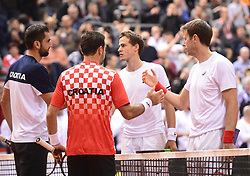 OSIJEK, Feb. 4, 2018  Marin Cilic (1st L) and Ivan Dodig (2nd L) of Croatia shake hands with Daniel Nestor (1st R) and Vasek Pospisil of Canada after the third match at Davis Cup World Group first round match between Croatia and Canada in Osijek, Croatia, on Feb. 3, 2018. (Credit Image: © Marko Prpic/Pixsell/Xinhua via ZUMA Wire)
