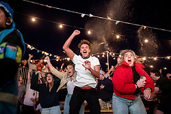 © Licensed to London News Pictures. 07/07/2021. London, UK. England fans celebrate at Tobacco Dock as Harry Kane scores the winning goal in the Euro 2020 semi-final between England and Denmark. Photo credit: Rob Pinney/LNP