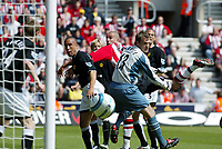 Photo. Chris Ratcliffe, Digitalsport<br /> Southampton v Manchester United. Barclays Premiership. 15/05/2005<br /> Roy Carroll and Mikeal Silvester of ManU and Danny Higginbottom of Saints can only watch as John O'Shea's own goal goes in.