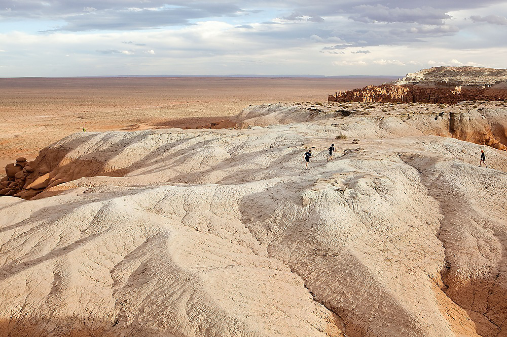 Leif Anderson and Francis Rengers trail run through the badlands on the high plateau at Goblin Valley State Park, Utah.