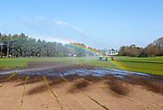 Irrigator machine spraying water turf farming, Sutton Heath, Suffolk, England, UK