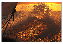 The breaking bow wave shining in the morning sunrise...Marc Turner / PFM pictures