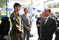French President Francois Hollande tours the Safran showroom of the strategic navigation center and attends the presentation of the Patroller drone during the inauguration of the Research and Development Center Safran Electronics and Defence, in Eragny, near Paris, France on October 5, 2016. Safran is an international high-technology group and supplier of systems and equipment in its core markets of Aerospace, Defense and Security. Photo by Christian Liewig/ABACAPRESS.COM