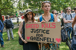 June 21, 2017 - London, UK - London, UK. 21st June 2017. Women hold a poster 'Greed Kills - Justice for Grenfell' at the start of Movement for Justice's 'Day of Rage' march, perhaps unfortunately named, allowing the right-wing media to indulge in a fantasy extravaganza imagining violent insurrection about Movement for Justice which has a long history of peaceful but active protests mainly aimed at the UK's iniquitous and illegal treatment of refugees and asylum seekers.  But there is today a great deal of entirely justified rage over the systemic failure to care about the provision of safe social housing which resulted in the deaths of well over a hundred people burnt alive in Grenfell Tower and still threatens many others. Many of the dead at Grenfell were asylum seekers and refugees, including a number who were undocumented and not recorded as residents. The marchers assured Grenfell residents who came to the start of the march that the predictions of violence were simply media inventions and that this was intended as a powerful but peaceful protest, and the residents present thanked the marchers for their solidarity and a number joined the several hundreds on the march as it set off to Parliament. Peter Marshall ImagesLive (Credit Image: © Peter Marshall/ImagesLive via ZUMA Wire)