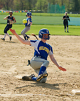 Gilford's Stevie Orton slides into third ahead of the throw during NHIAA DIvision III Softball with White Mountain on Wednesday afternoon.  (Karen Bobotas/for the Laconia Daily Sun)
