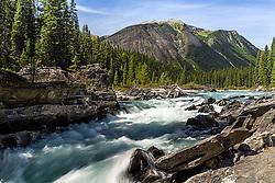 The rushing Kootenay River on a beautiful British Columbia day in Kootenay National Park.