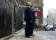 © Licensed to London News Pictures. 20/03/2013. Westminster, UK. Chancellor Of The Exchequer George Osborne, followed by Danny Alexander,  Liberal Democrat MP, Chief Secretary to the Treasury., poses for photographers whilst holding his red ministerial box outside 11 Downing Street In London, before presenting his annual budget to parliament today 20th March 2013. Photo credit : Stephen Simpson/LNP