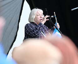 All Under One Banner March For Independence, Glasgow, Saturday 5th May 2018<br /> <br /> Thousands of people joined a march in support of Scottish Independence today in Glasgow.<br /> <br /> There were flags of many countries represented.<br /> <br /> Sandra White MSP addresses the huge crowd<br /> <br /> Alex Todd | EEm