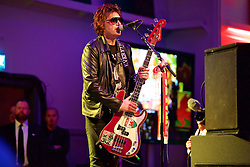 CARDIFF, WALES - Wednesday, June 1, 2016: Nicky Wire of The Manic Street Preachers performs for the Wales team during a charity send-off gala dinner at the Vale Resort Hotel ahead of the UEFA Euro 2016. (Pic by David Rawcliffe/Propaganda)