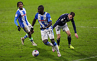 Huddersfield Town's Naby Sarr steals the ball from Millwall's Jed Wallace<br /> <br /> Photographer Alex Dodd/CameraSport<br /> <br /> The EFL Sky Bet Championship - Huddersfield Town v Millwall - Wednesday 20th January 2021 - The John Smith's Stadium - Huddersfield<br /> <br /> World Copyright © 2021 CameraSport. All rights reserved. 43 Linden Ave. Countesthorpe. Leicester. England. LE8 5PG - Tel: +44 (0) 116 277 4147 - admin@camerasport.com - www.camerasport.com