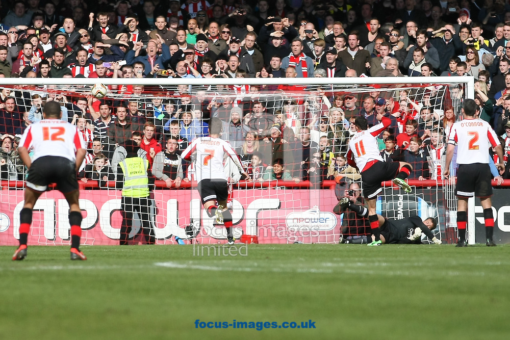 Picture by David Horn/Focus Images Ltd +44 7545 970036.27/04/2013.Marcello Trotta (11) of Brentford misses a penalty  during the npower League 1 match at Griffin Park, London.