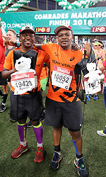 10062018 (Durban) Ayanda and Andile athletes who made it to the finnish line at the Mosses Mabhida stadium venue during the Comrades Marathon on Sunday as Bong'musa Mthembu and Ann Ashworth ensured that the coveted titles remained on these shores.<br /> Picture: Motshwari Mofokeng/African News Agency/ANA