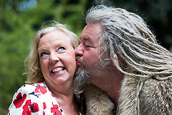 © Licensed to London News Pictures. 19/05/2014. London, England. Business woman Deborah Meaden (Dragon's Den) receives a kiss from an actor portraying a Viking at the Viking Cruises Norse Garden. Press Day at the RHS Chelsea Flower Show. On Tuesday, 20 May 2014 the flower show will open its doors to the public.  Photo credit: Bettina Strenske/LNP