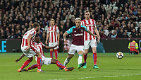 Football - 2017 / 2018 Premier League - West Ham United vs Stoke City<br /> <br /> Kurt Zouma (Stoke City) gets a foot in to deflect the ball before it reaches Marko Arnautovic (West Ham United) at the London Stadium<br /> <br /> COLORSPORT/DANIEL BEARHAM