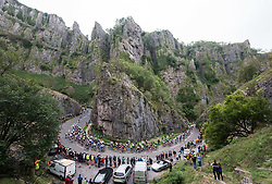 © Licensed to London News Pictures. 04/09/2018. Cheddar, Somerset, UK. OVO Energy Tour of Britain, stage 3. Cyclists climb up through the Cheddar Gorge on a King of the Mountain stage on the third day of the tour. Crowds watch from vantage points in the gorge including the cliff tops. Photo credit: Simon Chapman/LNP